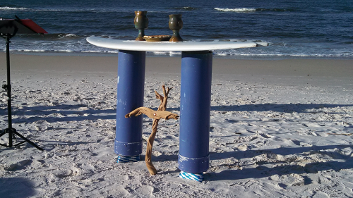 Driftwood cross, surfboard altar, and communion set